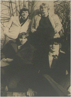 Caption: Sitting Pretty…standing at the back from left to right are Mike Turner, drummer and Greg Stevenson, keyboard player. Front left is Julian Amos, lead guitarist next to him Pete Long, bassist.